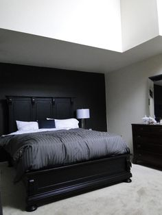 """Bedframe is St. James from Restoration Hardware, Mirror is Pottery Barn, Bedding is Bed Bath and Beyond, throw pillow is Ralph Lauren Home Brookstreet Collection. Black accent paint is Behr in """"Stealth Jet"""""""