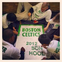Greg Stiemsma and 5th graders from Edison K-8 School in Brighton paint murals for the school as part of TD Bank's Helping Hands Day. #iamaceltic