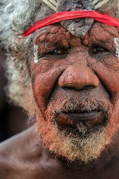 An elder from the Aurukun Dance group prepares for his first performance. Aurukun men typically prepare separately from the women.