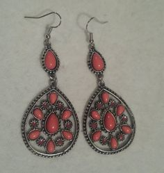 Check out these coral dangles in my Etsy shop https://www.etsy.com/listing/216900241/antique-silver-and-coral-dangle-earrings