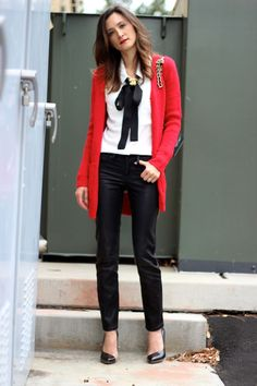Leather leggings, white blouse, black bow, red jacket