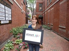 Local Portsmouth Resident, Sarah Scott, poses in Commercial Alley to support Street.life!