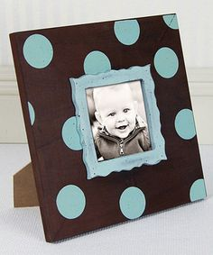 Share and enjoy special memories in the home each and every day. Featuring an easel back for displaying on tables and a built-in hanger for adorning walls, this sweet frame offers a pretty polka dot way to showcase cherished photos.