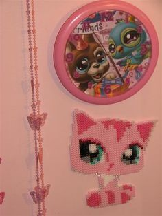 """I've really enjoyed looking at the customs and crafts here.   These are some little crafts my daughter and I have made from Perler Beads. There is a picnic blanket and """"pillows"""" to sit on, pizza and"""