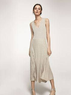 Autumn Spring summer 2017 Women´s KNIT DRESS WITH PLEATED DETAIL ON HEM at Massimo Dutti for 120. Effortless elegance!