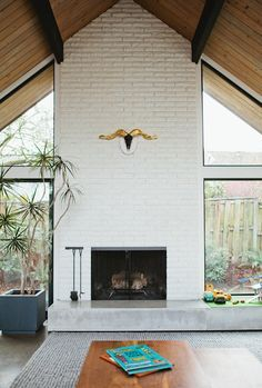 a frame house exterior with front center fireplace - Google Search