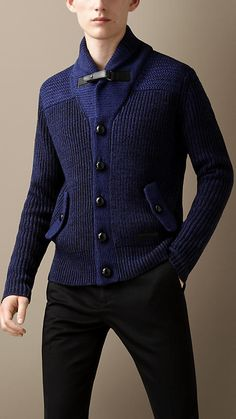 A refined shawl collar cardigan woven from a linen, wool and cotton blend. Set against smooth leather buttons and throat latch, the fisherman rib body presents a relaxed silhouette. The yoke, placket and collar are crafted in contrasting weaves for a unique appearance.