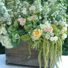 Country garden wedding arrangement in a old wooden crate... Love the contrast between the rustic container and lush florals