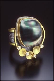 Beth Solomon.  Jewelry as miniature sculpture is the forte of Beth Solomon. This Massachusetts jeweler takes great pleasure in designing bold, graphic, and edgy jewelry with precious metals, pearls and fine gemstones, influenced by visual aspects of nature, architecture and antiquity.