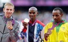 Men's 10,000-meter winners, from left, United States' silver medalist Galen Rupp, Britain's gold medalist Mo Farah, and Ethiopia's bronze medalist Tariku Bekele pose for photographers during the athletics in the Olympic Stadium at the 2012 Summer Olympics, London, Sunday, Aug. 5, 2012.