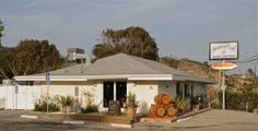 Oceanfront wine tasting at Rosenthal Wine Tasting Room and Garden Patio across from Topanga Beach in Malibu right on Pacific Coast Highway.