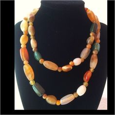 """Vintage Mixed Agate Gem Stone Long Necklace Gorgeous vintage mixed agate necklace.  Has various shape and color agate gem stones.  The round spacer beads are also agate. Screw closure.  In excellent condition.  Measures 34"""".  Please contact me if you have any questions Vintage Jewelry Necklaces"""