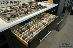 Use tension rods to organize spice drawer!!! Dream House: Spice Drawer