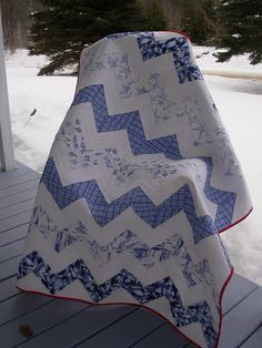 Blue & White Zig Zag with Red binding.  I would never have thought to use a red binding on a blue quilt!  It really makes it pop!