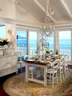 Lovely Dining Room Formality Of A Chandelier Oriental Rug Elegant White Yet Looks Casual Every In Beach Cottage Should Have This View