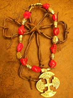 Awesome hot pink rock beads go perfectly with the antiqued silver beads and pendant on this cool necklace! $25