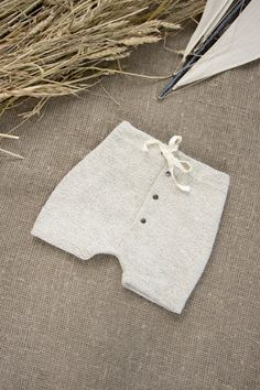 Lovely Cotton shorts with 3 snaps & natural cotton ribbon.  Perfect choice for a walk in a park!  Dress your little one in these stylish and modern shorts. The knit fabric is super soft and easy to move in. Seams are professionally serged to add durability. Available in sizes:  62 cm (24.4) 68 cm (26.8) 74 cm (29.1) 80 cm (31.5) 86 cm (33.9) 92 cm (36.2) 98 cm (38.6)  Composition:  100% cotton