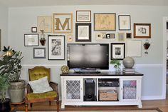 Great gallery wall. Love the large monogram w/ smaller letters hanging from the corner. | Beautiful Matters