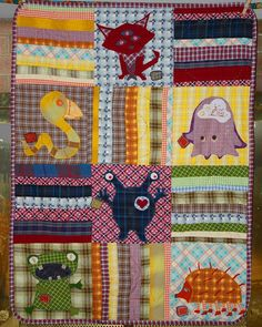 "Bellabinky made this applique baby quilt using cotton, cotton batting, and vintage fabrics. She used pieces of fabric to create the monsters and sewed the edges using a satin stitch on her sewing machine. The quilt was made for the daughter of a friend, ""who scorned the idea that girls' things should be limited to cutesy themes and pink."""