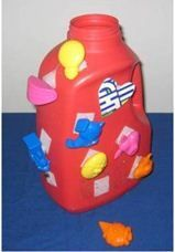 The Velcro Bottle – Remove the label from a detergent bottle by soaking in hot water and scraping it off with a butter knife. Attach small pieces of Hook Velcro to the bottle. Attach small pieces of Loop Velcro to small toys. The bottle's screw cap makes for nice storage. The child must stabilize the bottle while removing the toys to insert inside.