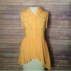 ⭐️ yellow peplum sleeveless top Size small, silver holes in front for accent. Button front, true color on mannequin phots, slight hi lo. NO TRADES/PAYPAL! Fast shipping! No swaps! No swaps! Tops