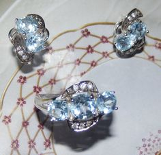 Gorgeous Set of Trilogy Ring, size 9, and Post Earrings wiih NATURAL Sky Blue Topaz GUARANTEED - SOLID 925 Sterling
