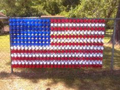 A resident in Odenville, AL puts Solo cups through their chain link fencing to a arrange it into an American flag.