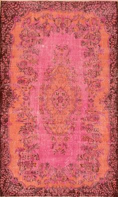 This distressed Over-Dyed rug is made from recycled vintage hand knotted Turkish rugs constructed from natural wool/cotton blend that have been shaved, bleached and then over-dyed with rich red and orange vegetable dyes.