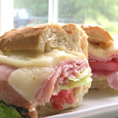Garden vegetable cream cheese takes these hot ham and cheese sandwiches to an out of this world meal idea. It's an easy recipe your family will love!