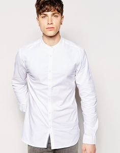 """Shirt by Jack & Jones Breathable cotton Grandad collar Button placket Regular fit - true to size Machine wash 100% Cotton Our model wears a size Medium and is 185.5cm/6'1"""" tall"""