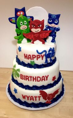 PJ Masks themed cake - 100% edible. The characters on the top and moon are custom cut and decorated sugar cookies. The characters on the cake sides are custom cut fondant.  Find more of my custom cakes and cookies on Facebook @ CookEeze by Shelly.