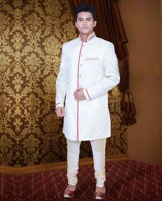 Off-white embroidered wedding sherwani   Off-white embroidered wedding sherwani intricate with zari thread, sequins work, neck work, buttons, beads work, floral work, leaf work and brocade work.Embroidered work is done on the backside of the sherwani. Embroidery on collar, shoulder and cuffs gives a charming effect.