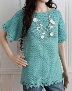 Watch Maggie review this Easy Boat Neck Tunic Crochet Pattern! ) Designs By: Joyce Bragg & Maggie Weldon Skill Level: Easy Sizes: To fit Women's -  Small