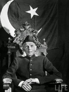 First Governor-General of Pakistan Muhammad Ali Jinnah Sitting in Front of Pakistani Flag - December 1947