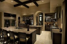 exciting dc ranch residence hallway interior design idea scottsdale az | gorgeous kitchen houzz.com. Black cabinets, travertine ...