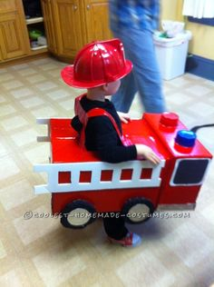 Coolest Homemade Firetruck Costume for a Toddler . This website is the… Toddler Boy Halloween Costumes, Baby Halloween, Cardboard Box, Fireman Party, Fantasias Halloween, Homemade Costumes, Toddler Fun, Holidays Halloween, Fire Trucks