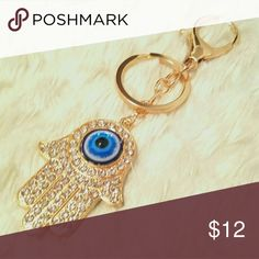 $8 If BundledHamsa Symbol Keychain/Charm NWOT Brand new gold-toned Hamsa symbol keychain/charm. Accessories Key & Card Holders