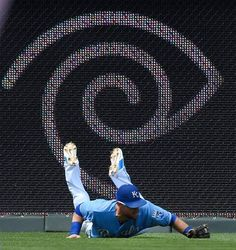 Kansas City Royals left fielder Alex Gordon (4) makes a sliding catch for an out on Minnesota Twins' Trevor Plouffe (24) in the ninth inning during Sunday's baseball game on July 5, 2015 at Kauffman Stadium in Kansas City, Mo.