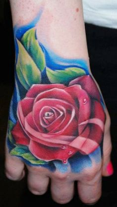 This rose hand tattoo is by the amazing Kyle Cotterman #tattoos #InkedMagazine #rose #hand #tattoo #Inked #ink #flower #floral