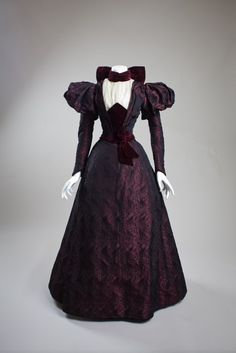 Eggplant silk brocade and velvet dress, American, 1890s. San Diego History Center.