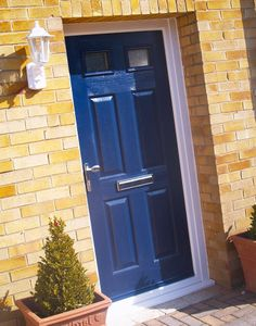 Navy Blue Composite door. A striking colour choice that made this house stand out from the rest.