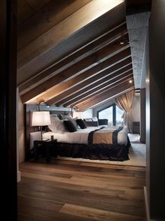 I love this cozy, tucked away bedroom with the warm, inviting colors - attic