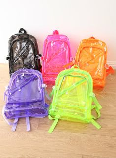 These awesome transparent backpacks are perfect for going back to school. They come in 5 colors: Orange, Pink, Black, and Purple,