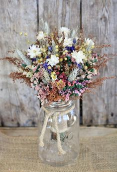 This listing is for a Country Girl Dried Flower Bouquet. I made this bouquet with fragrant preserved Sweet Annie, Annual Statice, Broom Corn, Flax, Wheat, Larkspur and Strawflowers. For a Touch of Country Charm, I tied it together with Burlap and Jute Twine. This Bouquet would be perfect for Bridal Bouquet Fall, Fall Wedding Bouquets, Bride Bouquets, Flower Bouquet Wedding, Wedding Centerpieces, Bridesmaid Bouquets, Wild Flower Wedding, Wedding Bridesmaids, Wildflower Centerpieces