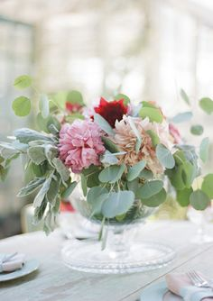 pink and red and leafy centerpiece
