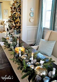 Mercury glass balls and candles with Evergreen for a simple table decoration