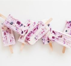 Satisfy your sweet tooth with these DIY berry and honey yogurt popsicles just in time for warm weather!