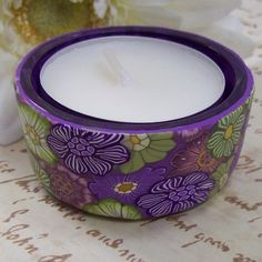 Polymer Clay Covered Tea Light Candle Holder. $5.99, via Etsy.