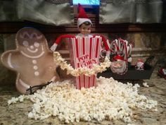 Elf makes a popcorn garland = Popcorn Mess!