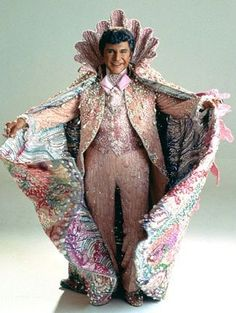 Liberace....I loved hearing him play the piano Awesome outfits I enjoyed that movie behind the candelabra
